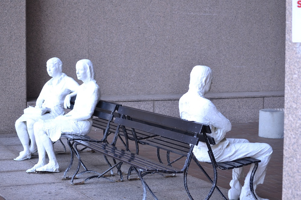 3 figures on 4 benches.JPG